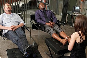 House (Hugh Laurie) and Foreman (Omar Epps) relax as they get massages