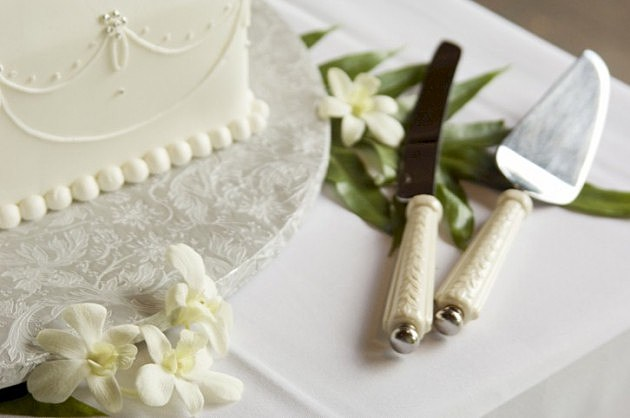 Wedding Cake and Knives - Thinkstock Photos