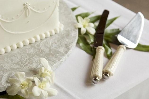 Wedding Cake and Knives - Thinkstock Photos