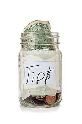 Tip jar with money