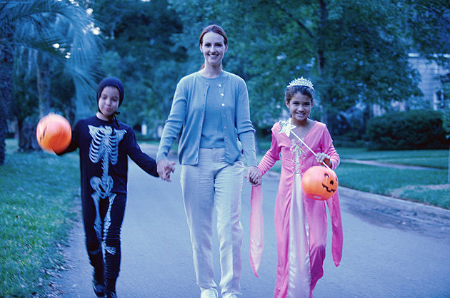 Mother with her son and daughter in Halloween costumes
